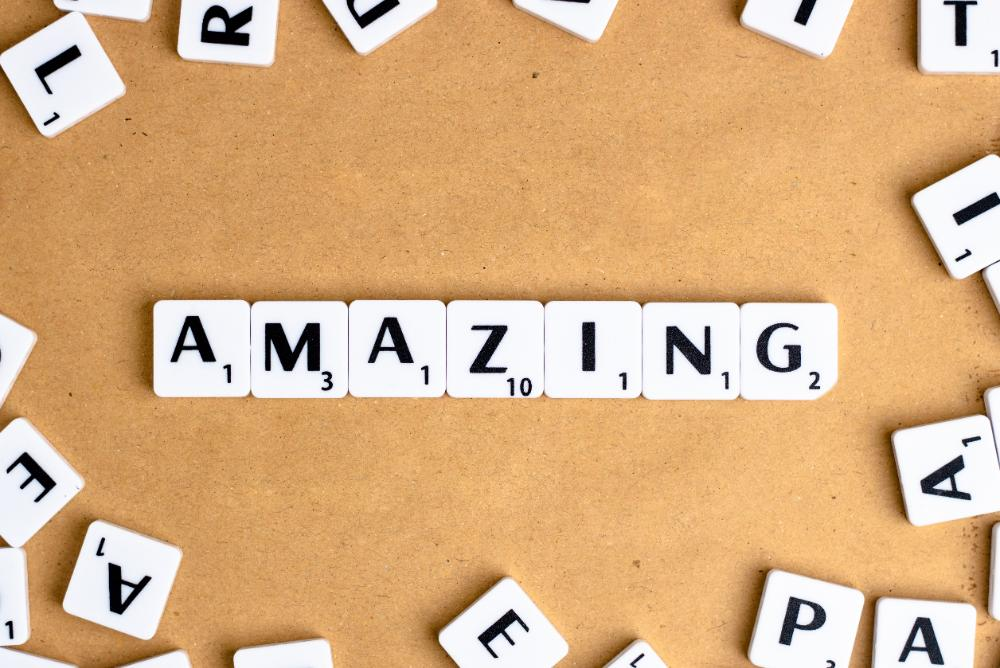 scrabble tiles spelling amazing