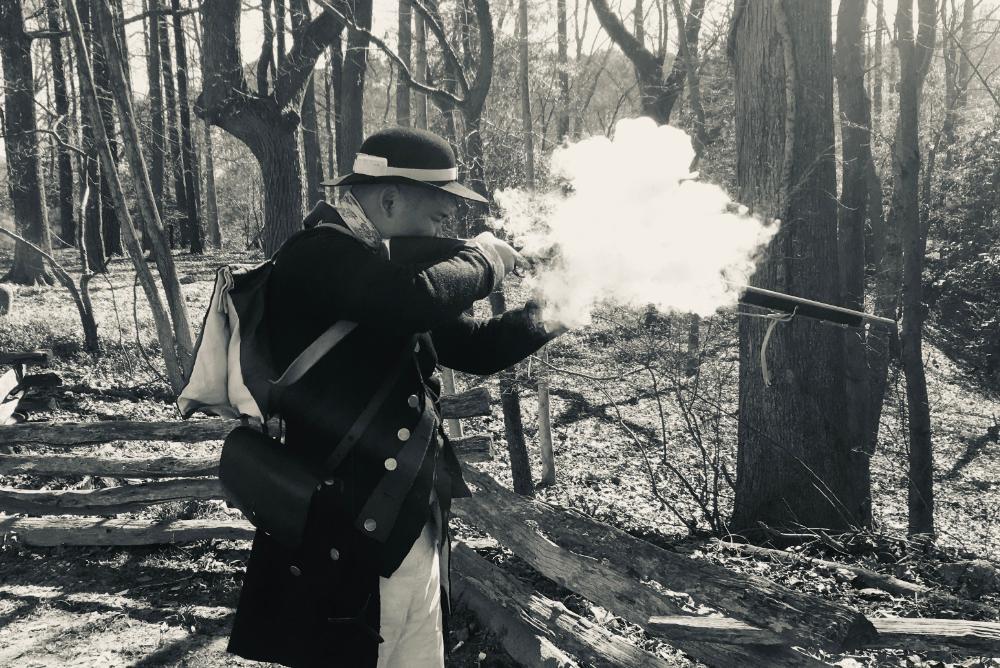 Company President Matthew Velasco troubleshoots a musket.