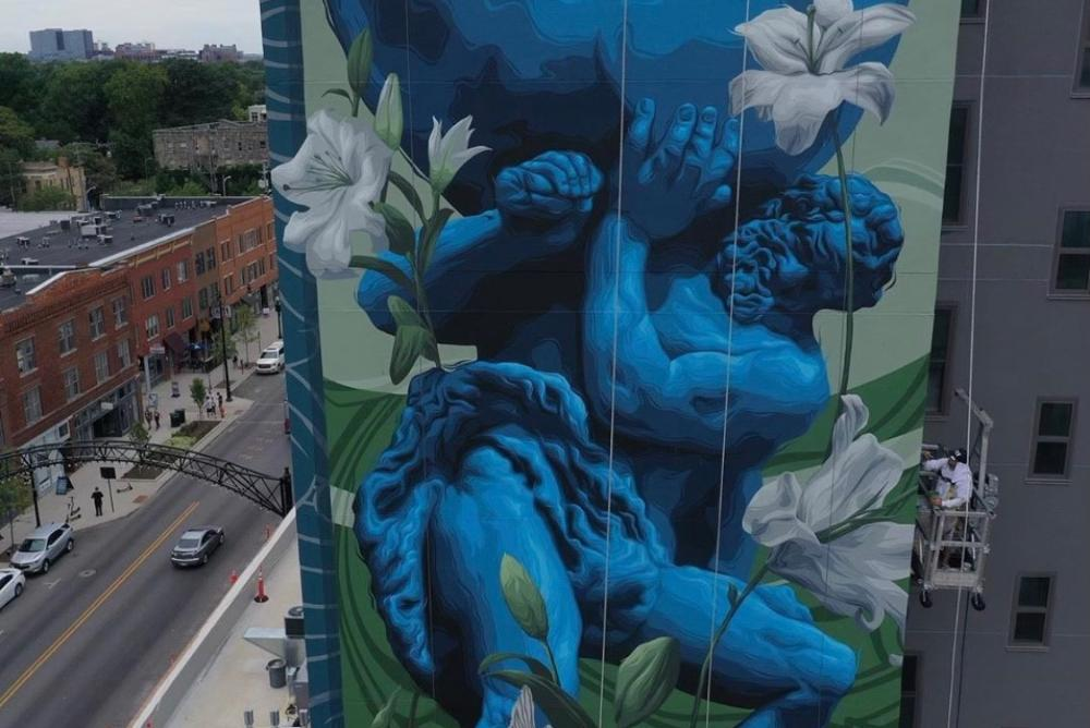 Mural artist painting mural