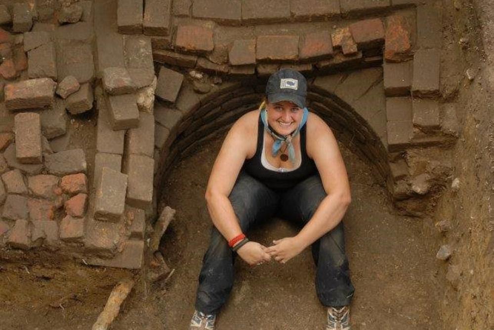 woman, bricks, dirt, hole