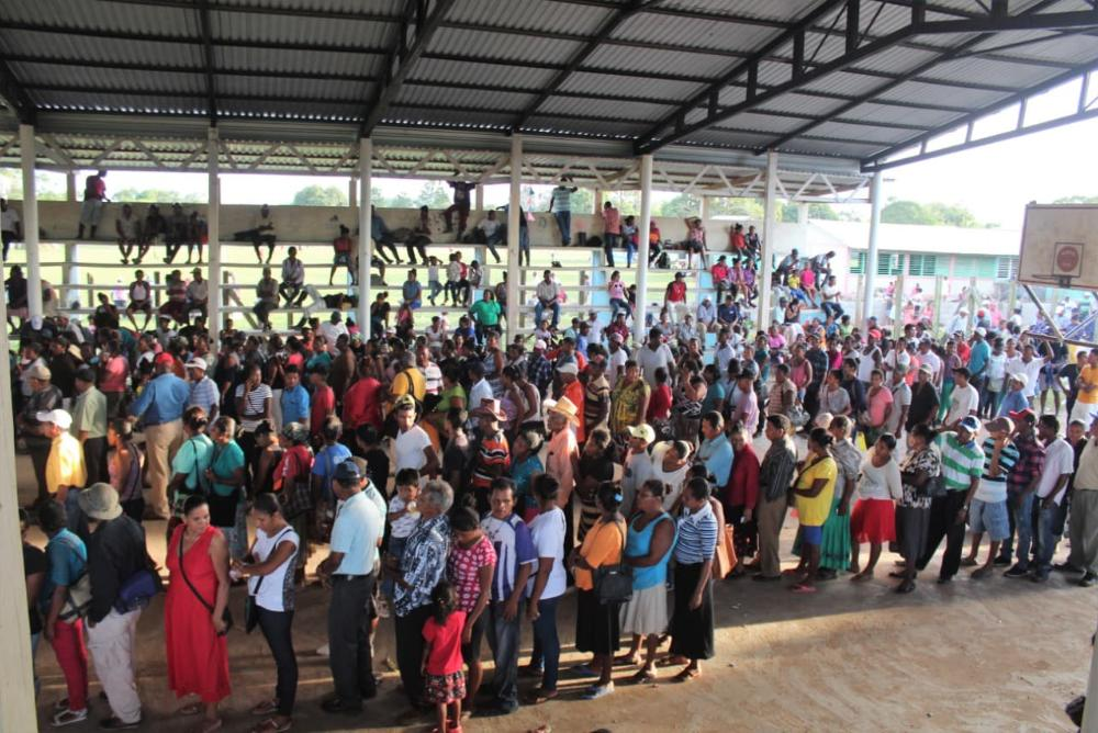crowd of people, colorful clothes, under a roof