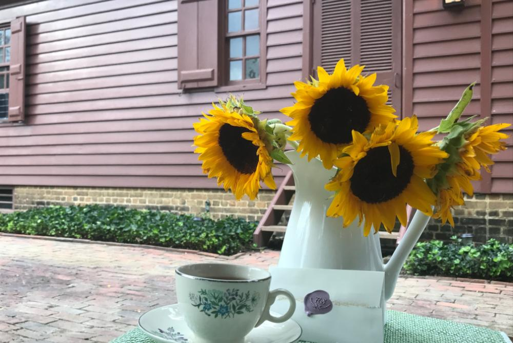 Tea and flowers in front of the CW House
