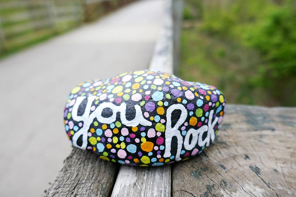 Painted rock with the message