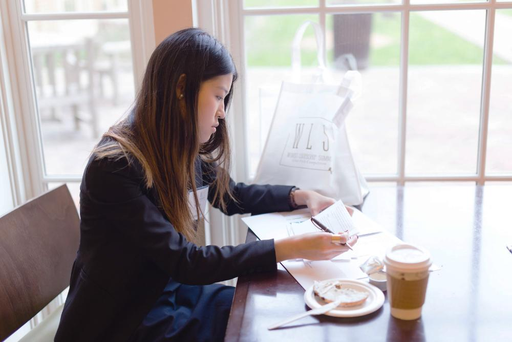 A business student working in Miller Hall.