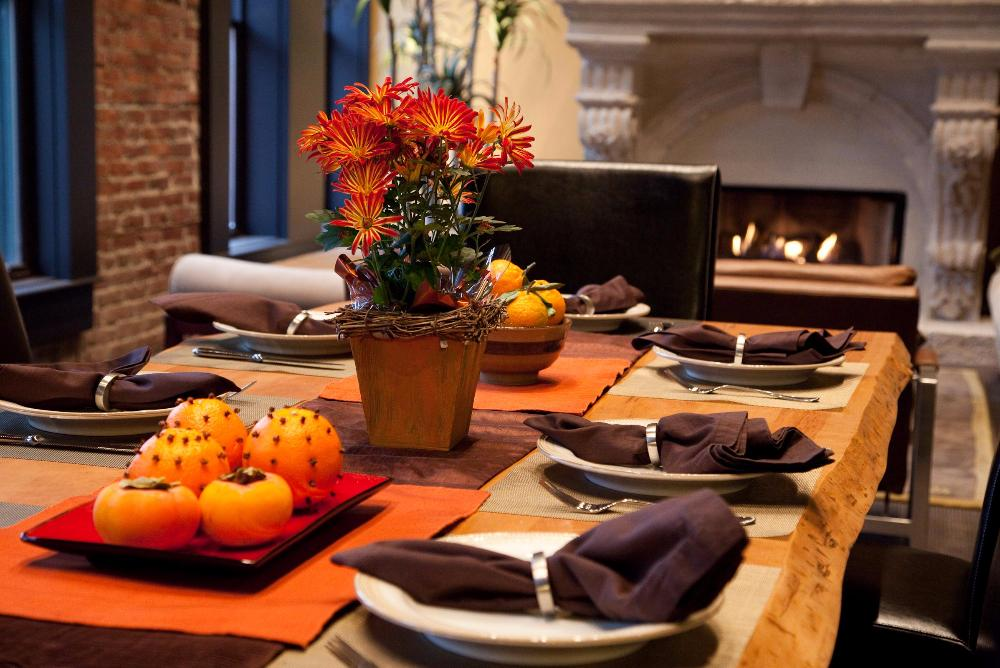 A thanksgiving table and fireplace.