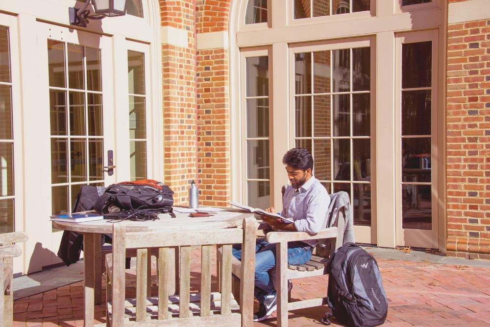 A student studying outside of Miller Hall.