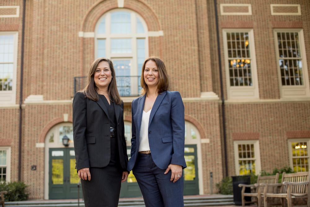 Two Online MBA students standing in front of Miller Hall.