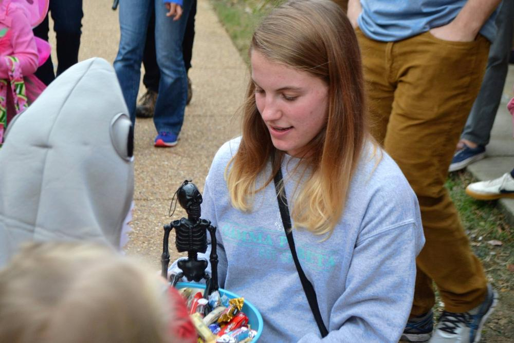 A member of Gamma Phi Beta hands out candy at last year's event.
