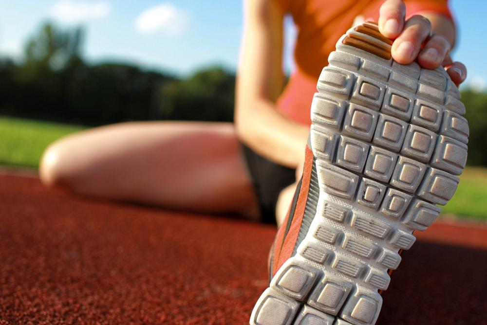 Image of a runner stretching before a race.