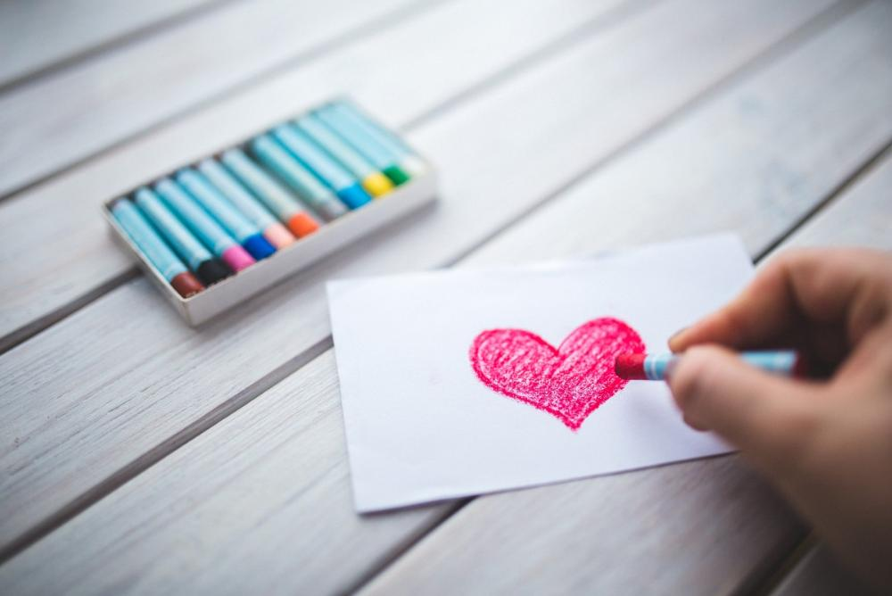 Hand Drawing a Pink Heart