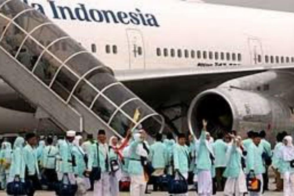Contemporary pilgrims board a Garuda Indonesia plane for Mecca, Saudi Arabia
