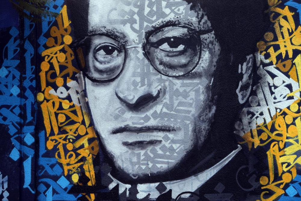 Mahmoud Darwish painted on a street in Beirut by Yazad Halwani