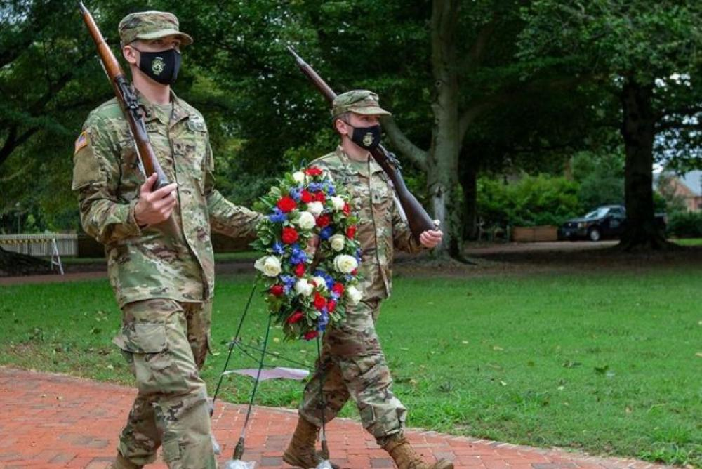 Cadets post the memorial wreath at the head of the sunken gardens.