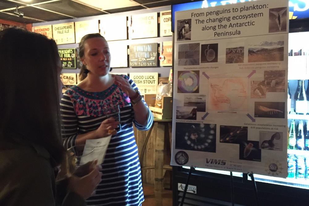 Tricia Thibodeau discusses her research in Antarctica with an audience member during a recent