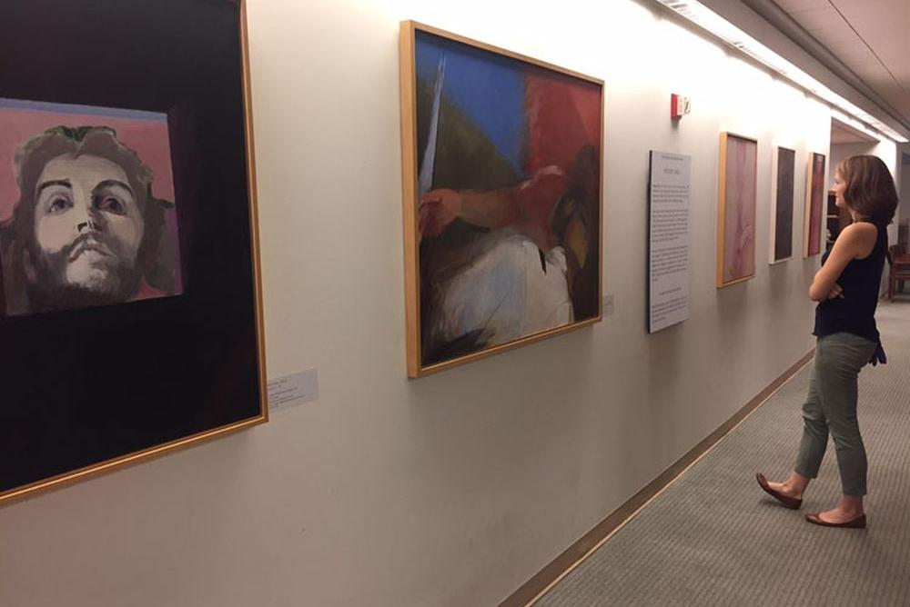 Installation view of paintings by Roser Bru located on the second floor of Swem Library.