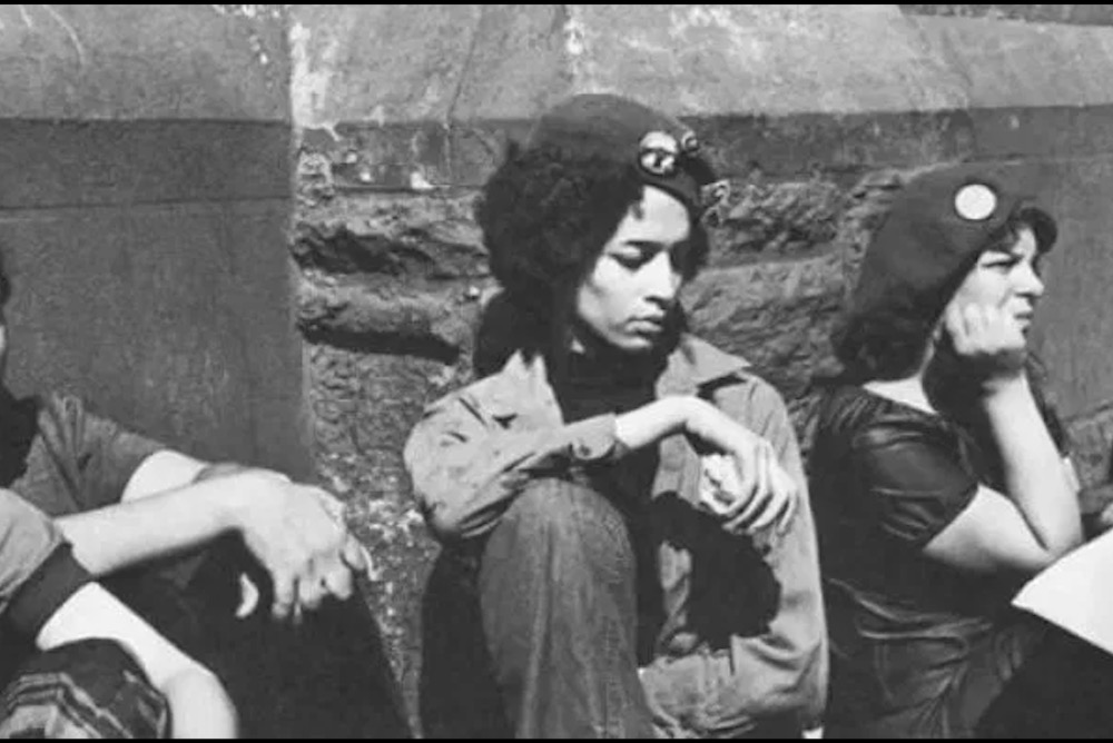 Denise Oliver-Velez (center) and Iris Morales (right) from the Young Lords