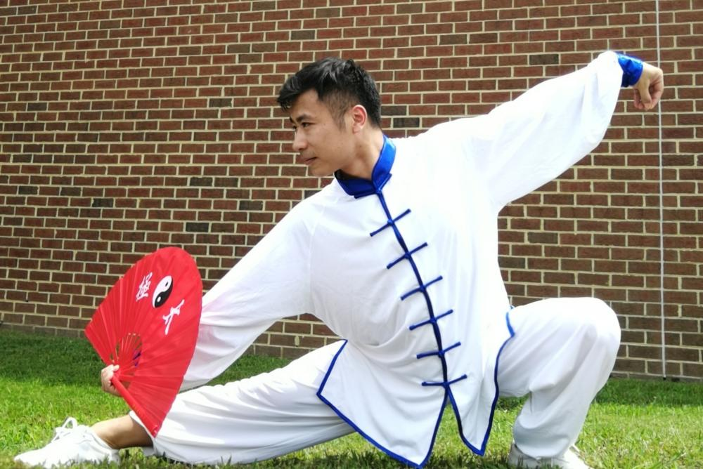 Instructor Xiusen Pan shows off his graceful Taiji fan techniques
