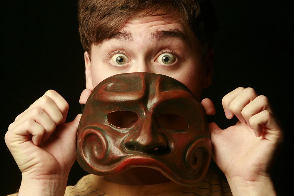 A person holding a mask