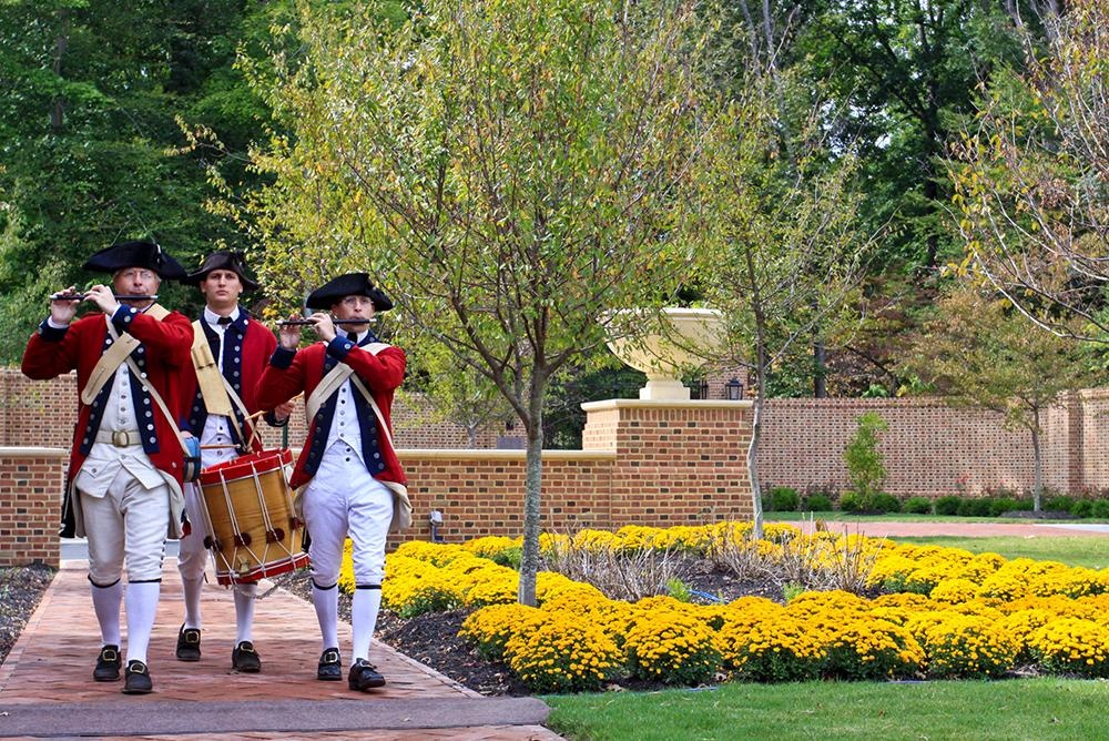 outdoors, outside, people, colonial williamsburg, fifes and drums, trees, flowers, uniforms, mason,