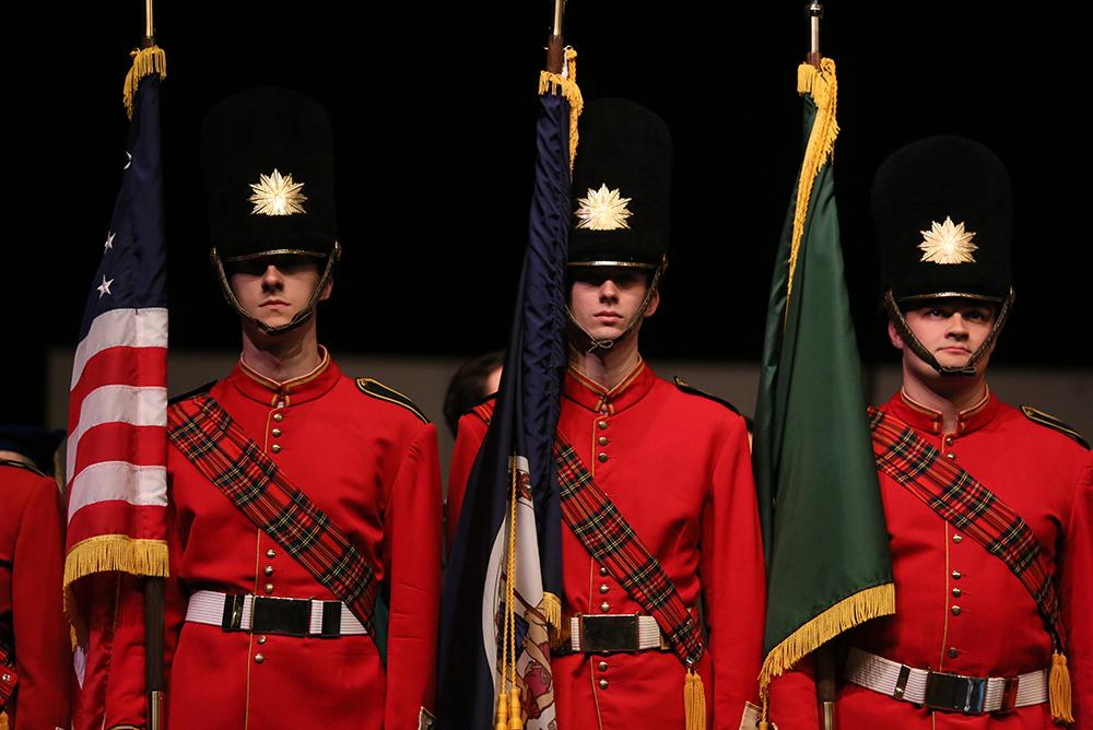 indoors, inside, people, students, queens guards, flags, uniforms, kaplan arena, traditions