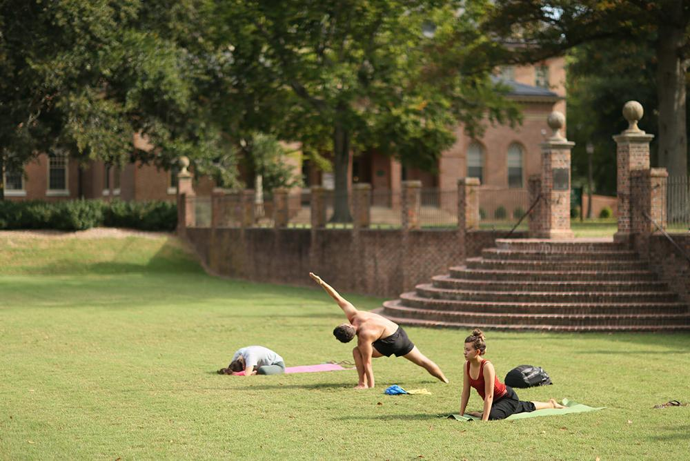 students, outdoors, outside, people, yoga, sunken garden, trees, fitness, exercise, bricks