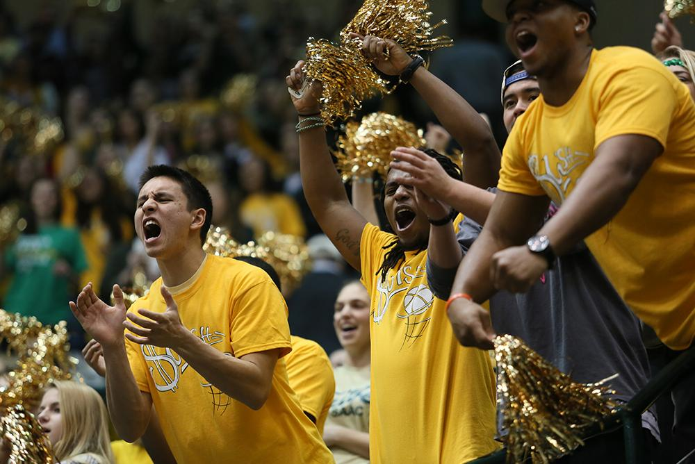 Students cheering on the Tribe at a Gold Rush Game.