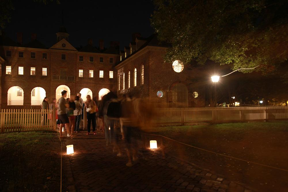 students, outdoors, outside, people, family, families, family weekend, wren, lanterns, night, courtyard, candles