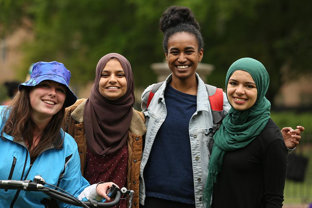 Four students smiling at the camera