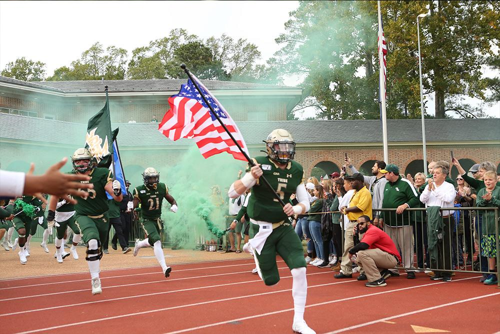 outdoors, outside, stadium, zable, football, athletics, sports, fall, autumn, tribe, flags, fans, cheering, spirit